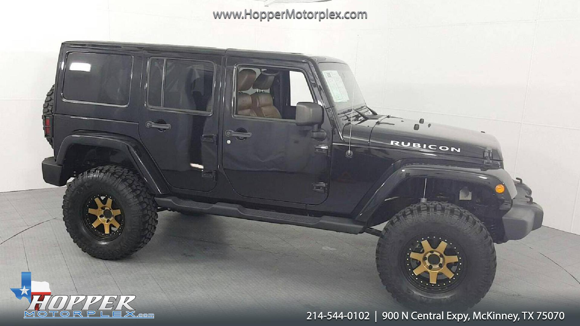 2012 Jeep Wrangler Unlimited Rubicon Lifted W Custom Tires And White Sahara With Tire Carrier Led Tail Lights 1